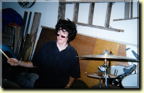 Picture of our drummer, Denny, with a fro wig on.